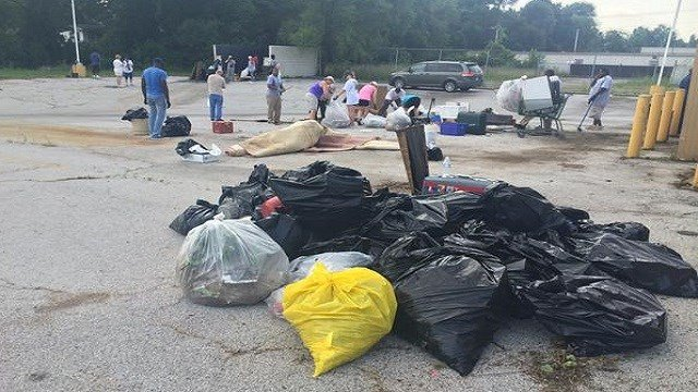 Volunteers cleaned up West Florissant on Monday morning.