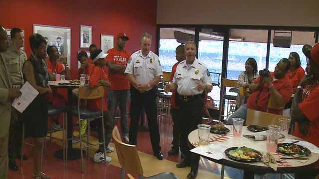 Police chiefs from Ferguson St. Louis City, and St. Louis County joined with 30 African American teenagers at Busch Stadium Tuesday.