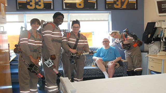 """The all-female cast of the upcoming """"Ghostbusters"""" remake visited children at Tufts Medical Center in Boston, Massachusetts, on Saturday, August 1, 2015. (Credit: Tufts Medical Center)"""