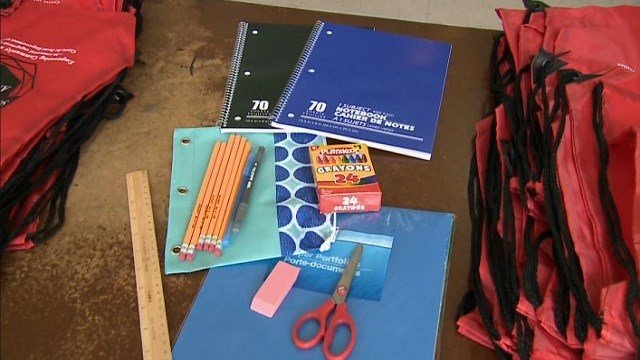 Volunteers stuffed backpacks with school supplies for Ferguson area students.