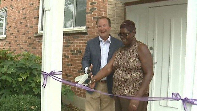 A ribbon-cutting ceremony was held for the new roof at the Women in Transition center.