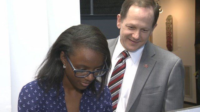 Participant Jordan Butler shows Mayor Francis Slay the video game she developed in her internship.