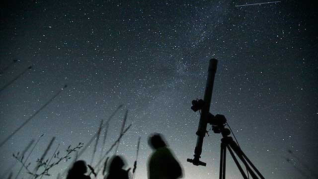 Astronomers observe the night sky for the Perseid meteor shower at an observatory near the village of Avren east of the Bulgarian capital Sofia, Wednesday, Aug. 12, 2009. (AP Photo/Petar Petrov)
