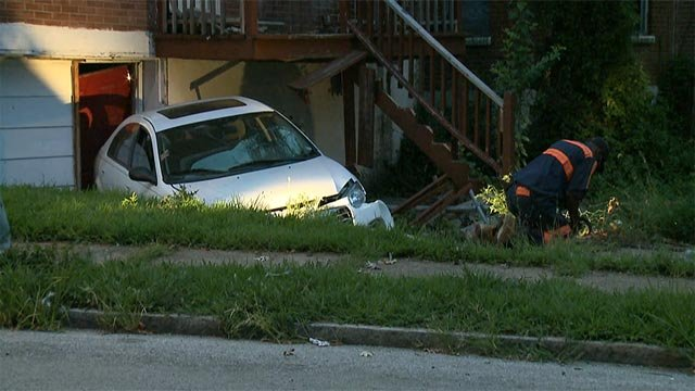 A car was abandoned after it crashed into a north St. Louis home Friday morning