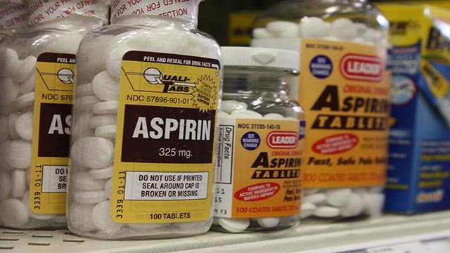 Bottles of aspirin sit on a pharmacy shelf. Keywords: pain reliever, advil. leader, products, bufferin (Credit: David Rust/CNN)