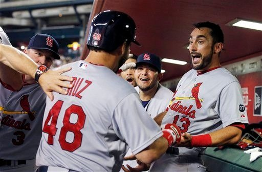 St. Louis Cardinals' Tony Cruz (48) celebrates his home run against the Arizona Diamondbacks with teammates Matt Carpenter (13) and Yadier Molina during the second inning of a baseball game Thursday, Aug. 27, 2015, in Phoenix. (AP Photo/Ross D. Franklin)