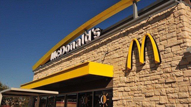 An exterior angle photograph of a new style McDonald's Restaurant.