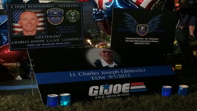 Residents and fellow police officers gather at the Fox Lake, Illinois Police Department on September 2, 2015, to remember the life of Lt. Joe Gliniewicz. Gliniewicz was shot and killed on Tuesday while chasing three suspects.