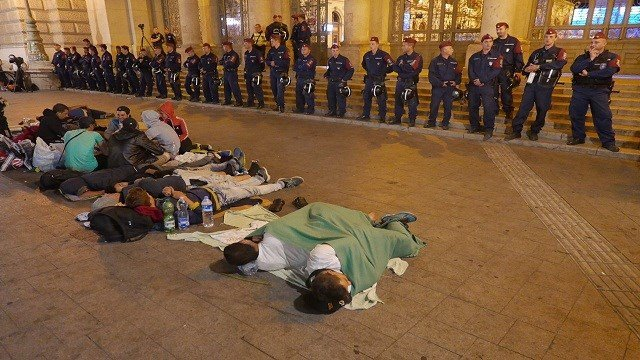 A line of Hungarian police blocking the entrance to Keleti Station while Syrian refugees camp out another night on September 2, 2015.