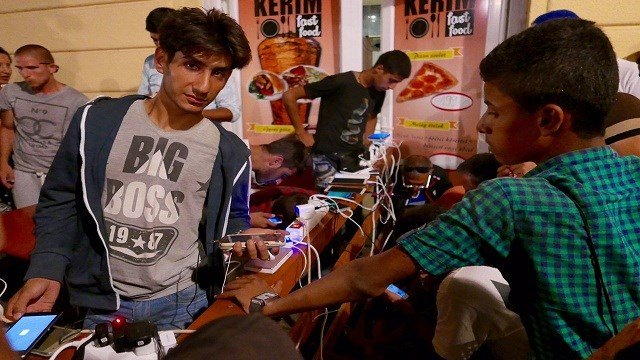 Local pizza place offers free power to refugees to charge their phones in Budapest, Hungary on September 2, 2015.