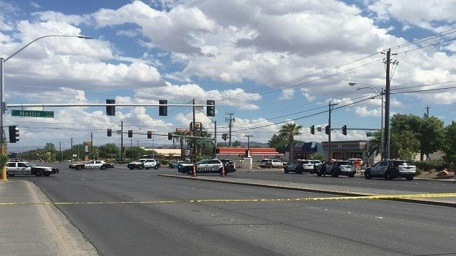 A man with a semiautomatic handgun ambushed two officers who'd stopped their patrol car at a traffic light in Las Vegas on Sunday, September 6, 2015, police said.