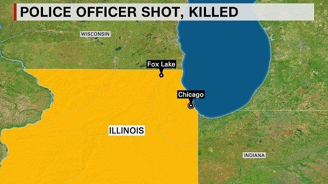 A police officer was shot and killed in Lake County, Illinois, authorities said September 1, 2015. Law enforcement officials searched the area on food and in helicopters looking for multiple suspects in the attack.