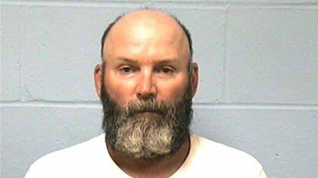 Bill Curtis, 52, is charged with home invasion and theft. He allegedly broke into an elderly man's home in Macoupin County and then called 911 admitting to his actions