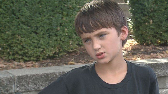 An 8-year-old boy helped Edmundson police solve a crime after someone offered him $100 at a community park.