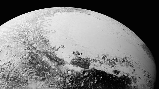 This 220-mile (350-kilometer) wide view of Pluto from NASA's New Horizons spacecraft illustrates the incredible diversity of surface reflectivities and geological landforms on the dwarf planet. (Credit: NASA/Johns Hopkins/SRI)