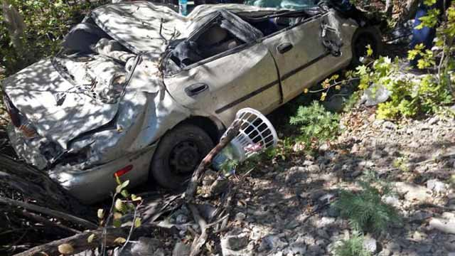 This Thursday, Sept. 10, 2015 photo provided by the Utah County Sheriff's Office shows the area where a woman in her car plunged off the side of road in American Fork Canyon southeast of Salt Lake City. Heather Blackwelder had spent two days in the wrecka