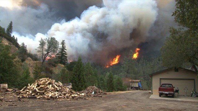 Thousands in northern California fled for their lives as brutal wildfires gobbled up their homes by the hundreds Sunday, September 13, 2015.