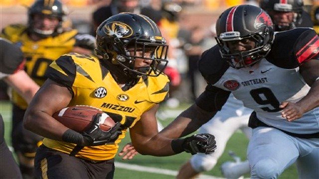 Missouri running back Ish Witter, left, tries to run past Southeast Missouri State's Terrance Hill, right, during the third quarter of an NCAA college football game Saturday, Sept. 5, 2015, in Columbia, Mo. (AP Photo/L.G. Patterson)