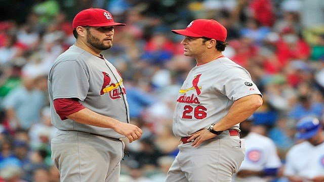 SEPTEMBER 18: Mike Matheny #26 manager of the St. Louis Cardinals takes Lance Lynn #31 out of the game against the Chicago Cubs during the fourth inning on September 18, 2015 at Wrigley Field in Chicago, Illinois. (Photo by David Banks/Getty Images)