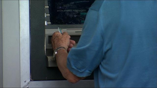 Man at ATM (Credit: CNN)