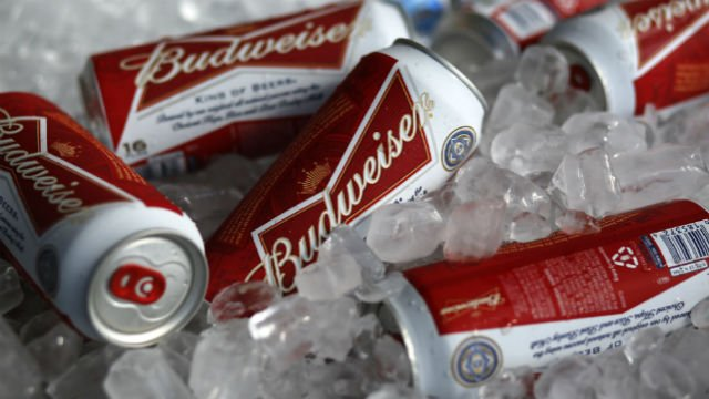 "Budweiser brewer Anheuser-Busch InBev has raised its takeover bid for SABMiller to 70.4 billion pounds ($108.2 billion) Monday, Oct. 12, 2015 in its latest effort to win backing for its plan to create ""the first truly global beer company."" (AP Photo/Gene"