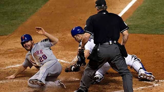 New York Mets' Daniel Murphy scores past Chicago Cubs catcher Miguel Montero during the seventh inning of Game 3 of the National League baseball championship series Tuesday, Oct. 20, 2015, in Chicago. Murphy scored from third on a ball hit by Lucas Duda