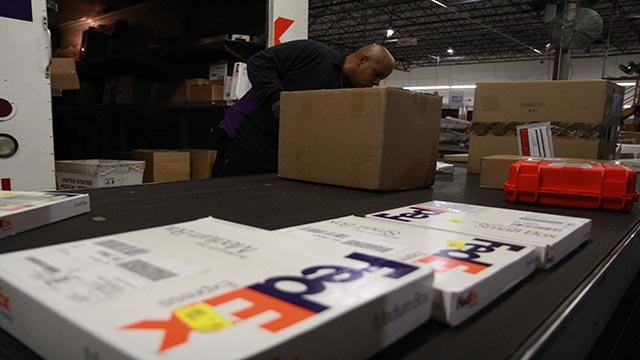 FedEx (Federal Express) prepares for the onslaught of holiday shipping at an Atlanta, Georgia sorting facility in December 2012. (Credit: CNN)