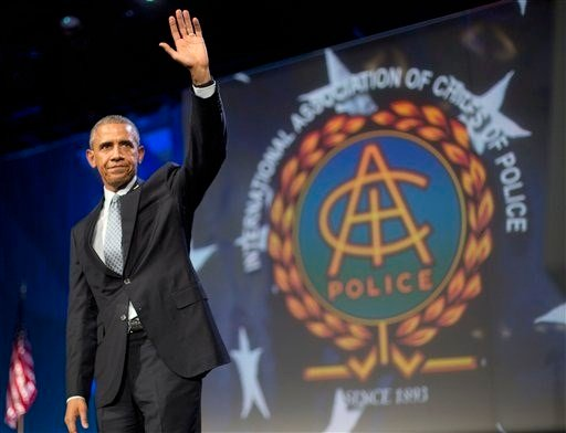 President Barack Obama waves after speaking at the 122nd International Association of Chiefs of Police Annual Conference, Tuesday, Oct. 27, 2015, in Chicago. (AP Photo/Pablo Martinez Monsivais)