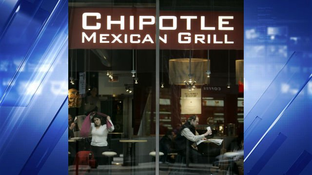 Diners are seen through the front window of a Chipotle Mexican Grill restaurant in this Jan. 24, 2007 file photo, in downtown Chicago. (AP Photo/M. Spencer Green, file)