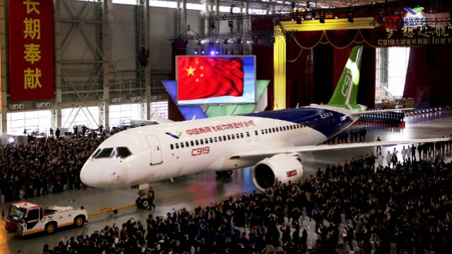 The first twin-engine 158-seater C919 passenger plane made by The Commercial Aircraft Corp. of China (COMAC) is pulled out of the company's hangar during a ceremony near the Pudong International Airport in Shanghai, China, Monday, Nov. 2, 2015. (AP Photo)