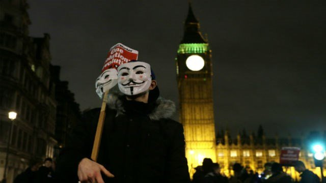 Thousands of people dressed in Guy Fawkes masks are being met by 'significant policing operation', including thousands of extra officers to tackle expected unrest in this annual march that coincides with the Nov. 5 Bonfire Night  (AP Photo/Tim Ireland)