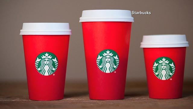 This year's holiday season red cups at Starbucks have stirred up critics who accuse the company of waging a war on Christmas. (Credit: Starbucks)