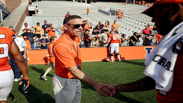 In this Sept. 5, 2015 file photo, Illinois athletic director Mike Thomas congratulates players after an NCAA college football game against in Champaign, Ill. (Credit: AP Photo/Stephen Haas, File)