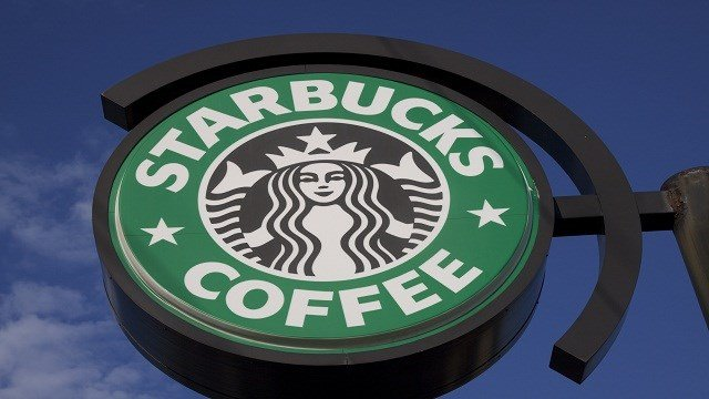 A close-up photograph showing a Starbucks sign attached to a building located in Atlanta, Georgia. (Photo: Ferre' Dollar/CNN)