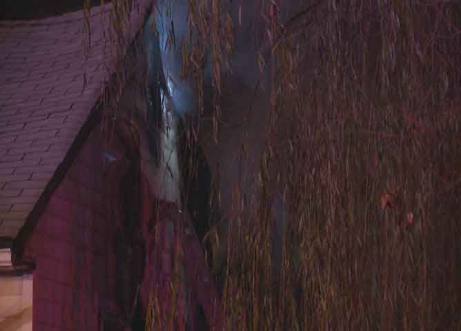 Smoke can be seen billowing out a window during a blaze at home near Midland and Osgood.