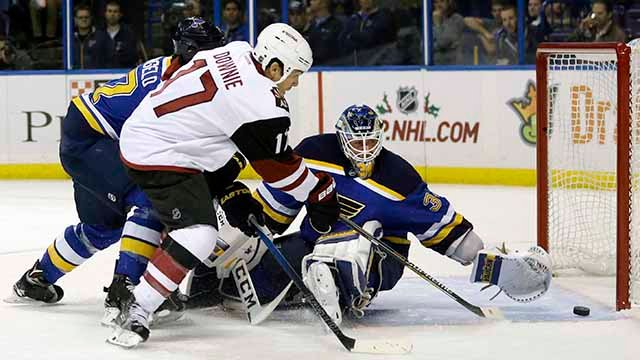 Arizona Coyotes' Steve Downie (17) scores past St. Louis Blues goalie Jake Allen, right, and Alex Pietrangelo, left, during the first period of an NHL hockey game Tuesday, Dec. 8, 2015, in St. Louis
