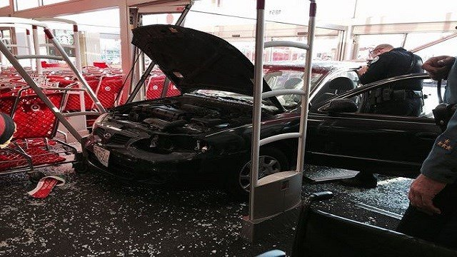 A man drove his vehicle into the store front of a Target. (Credit: emissourian.com)