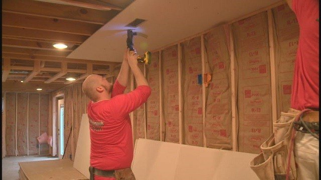 Volunteers working on Chris Sanna's home to make wheelchair accessible