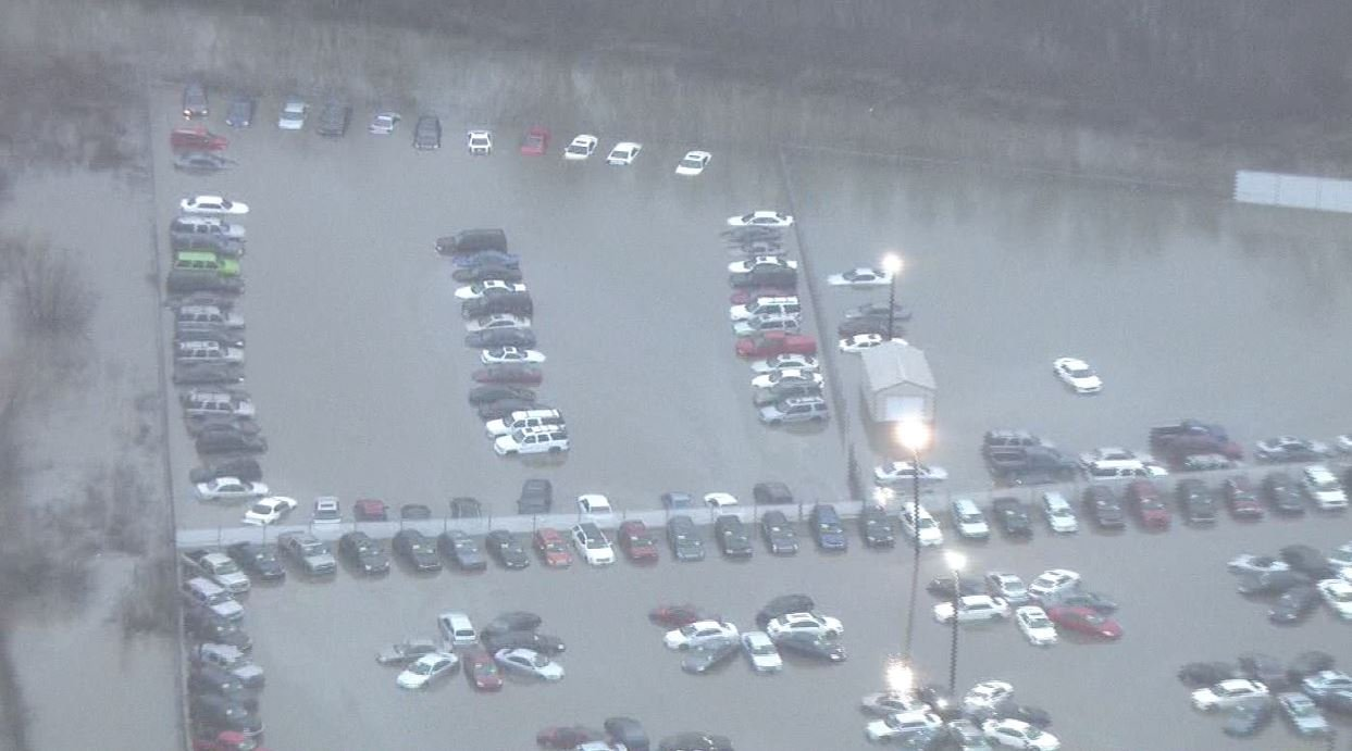 Vehicles submerged in water at the Pay Later Auto Sales in Cahokia