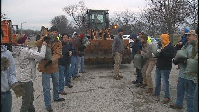 Volunteers came out in large numbers to help sand bag.