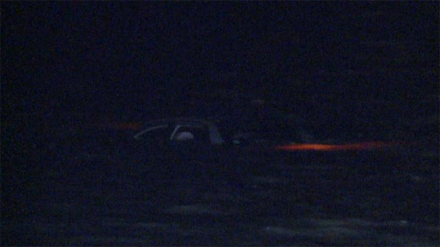 Three people had to be removed after a vehicle became trapped by flood waters on Highway 67 around 2:25 a.m.