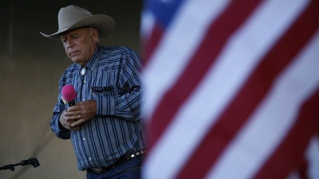 Rancher Cliven Bundy speaks at an event Saturday, April 11, 2015, in Bunkerville, Nev. Bundy was holding the event to celebrate the one year anniversary since the Bureau of Land Management's failed attempt to collect his cattle.(AP Photo/John Locher)