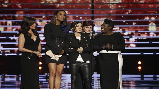 The cast of The Talk on stage during the PEOPLE'S CHOICE AWARDS 2016, from the Microsoft Theater on Wednesday, Jan. 6, 2016. An unidentified stage-crasher grabbed the microphone briefly during their speech. (Credit: Sonja Flemming/CBS)