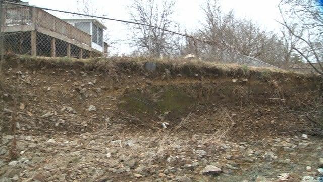 Eroding land near Fenton, Mo. home