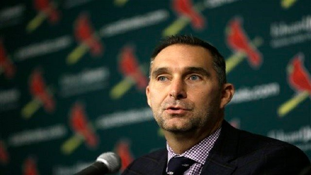 St. Louis Cardinals general manager John Mozeliak speak during a news conference announcing the signing of free-agent pitcher Mike Leake to a contract to play baseball for the St. Louis Cardinals Tuesday, Dec. 22, 2015, in St. Louis. (AP Photo/Jeff Robers