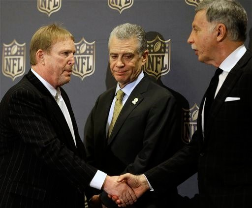 Oakland Raiders owner Mark Davis, left, shakes hands with St. Louis Rams owner Stan Kroenke, right, as Pittsburgh Steelers president Art Rooney II looks on after an NFL owners meeting Tuesday, Jan. 12, 2016, in Houston. (AP Photo/Pat Sullivan)