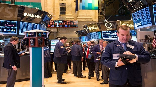 Traders work on the floor of the New York Stock Exchange in this file photo. (Credit: John R. Couglin/CNNMoney)