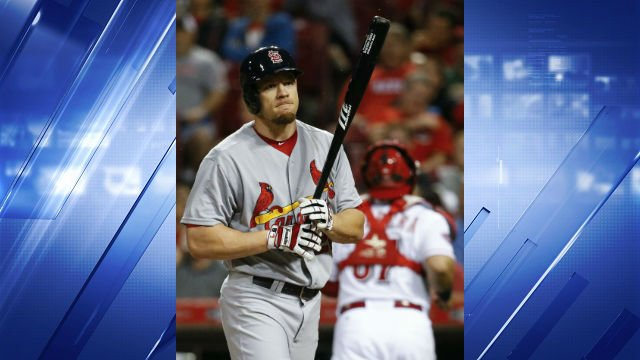 St. Louis Cardinals' Brandon Moss reacts after striking out in the third inning of a baseball game against the Cincinnati Reds, Friday, Sept. 11, 2015, in Cincinnati. (AP Photo/John Minchillo)