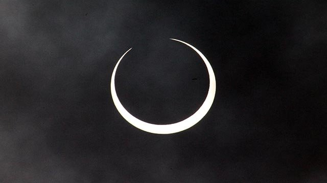 Solar eclipse nears its totality in Nairobi, Kenya, Friday Jan. 15, 2009. Kenyans got a rare glimpse of the annular solar eclipse which saw the sun completely ringed by the moon and despite some clouds could be seen for about 10 min.(AP Photo/Sayyid Azim)