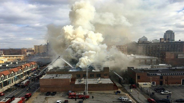 Smoke seen coming from a building fire in the 1900 block of Washington Avenue. The fire spread to 4-alarm. (Credit: Marek Bozek)